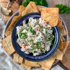Overhead view of a bowl of crab dip with crackers