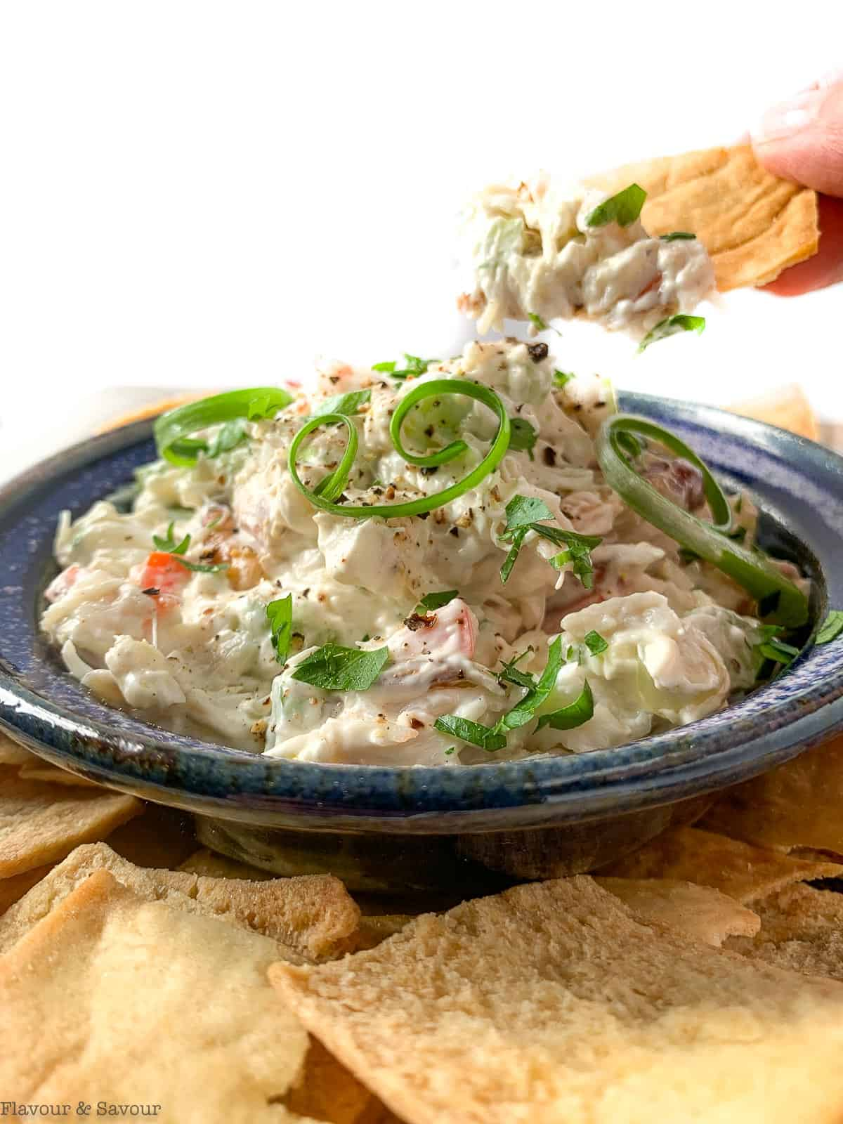 A scoop of cold crab dip on a cracker