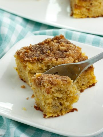 a forkful of Grain Free Banana Coffee Cake on a turquoise cloth