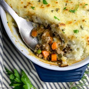 Close up view of homemade Shepherd's Pie with a serving spoon