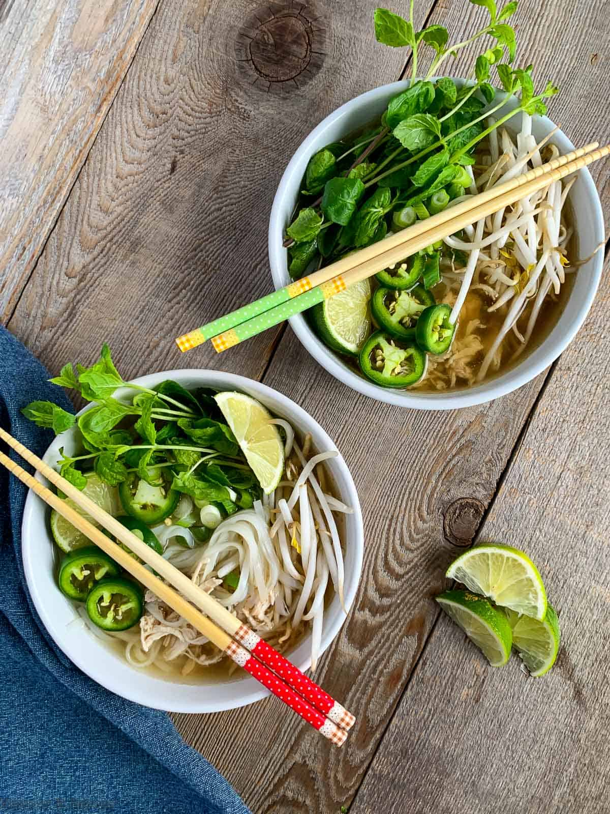 Two bowls of Chicken Pho (Pho Ga) also known as Vietnamese Chicken Noodle Soup