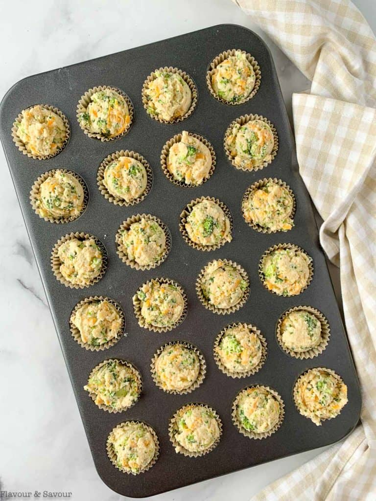 mini muffin tin filled with muffin batter