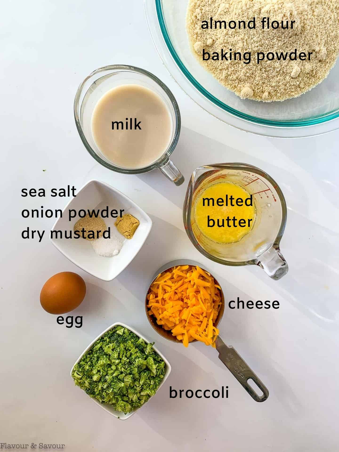 Ingredients with labels for mini gluten-free broccoli cheese muffins