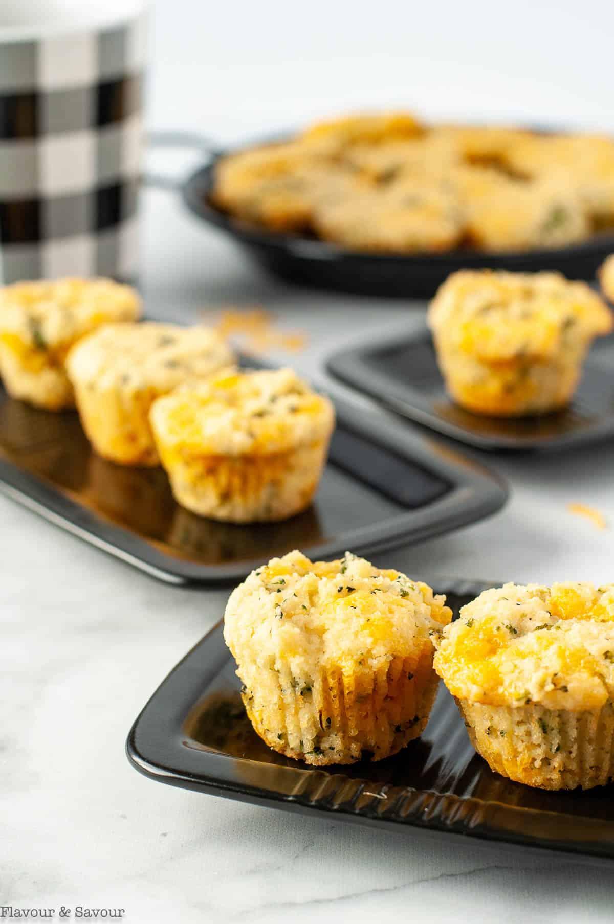 Mini Broccoli Cheese Muffins on small black plates.
