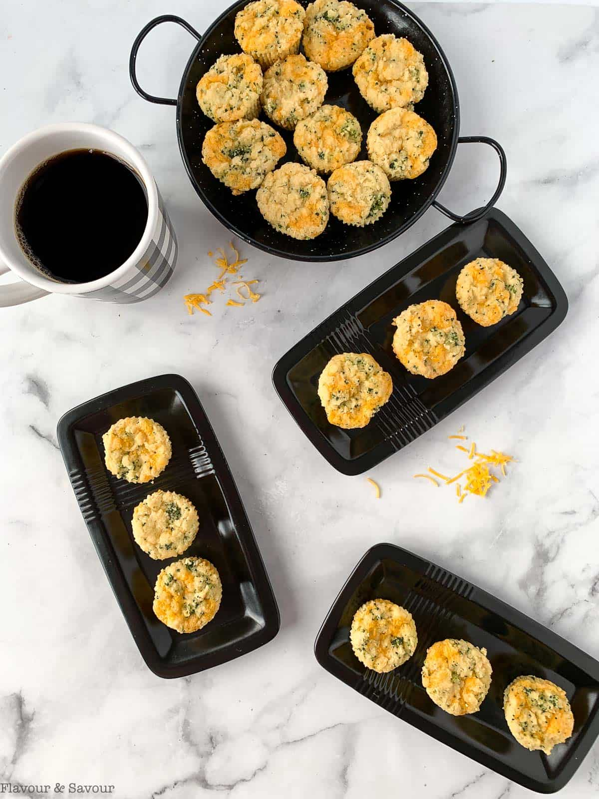 Gluten-free Broccoli Cheddar Muffins on small black serving plates.
