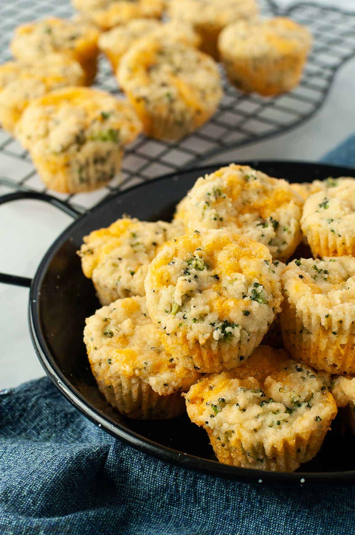 Overhead view of a bowl of broccoli cheddar muffins