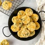 Overhead view of a black serving dish with mini Broccoli Cheese Muffins