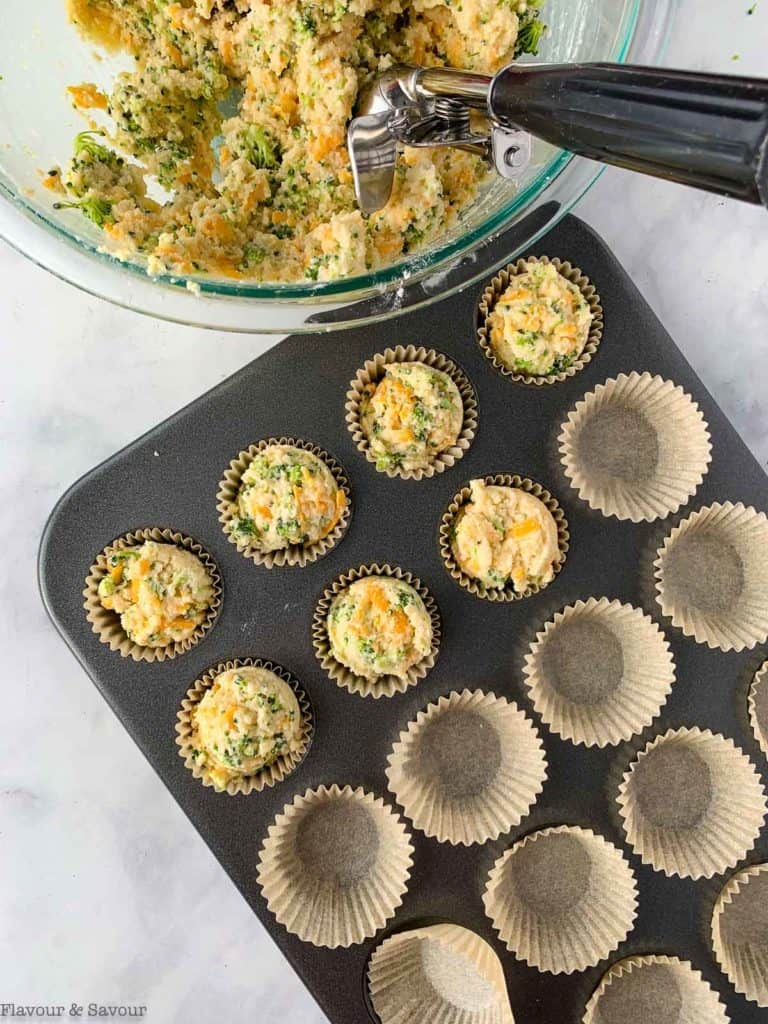 Filling muffin cups with muffin batter