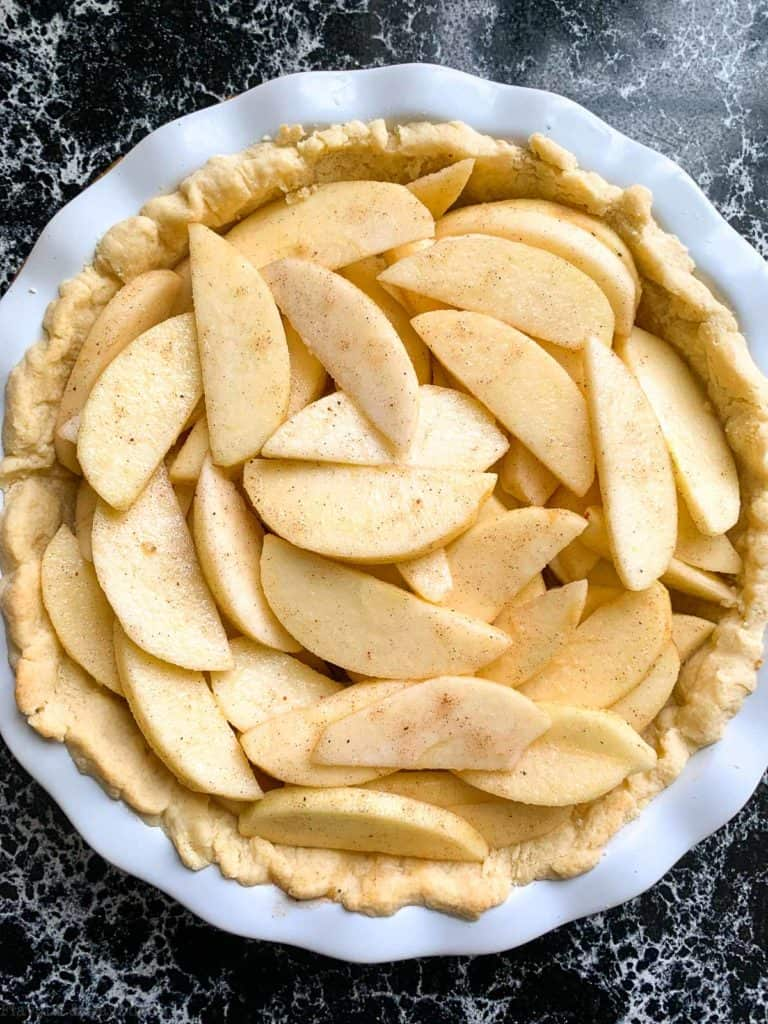 Sliced apples in pie crust.