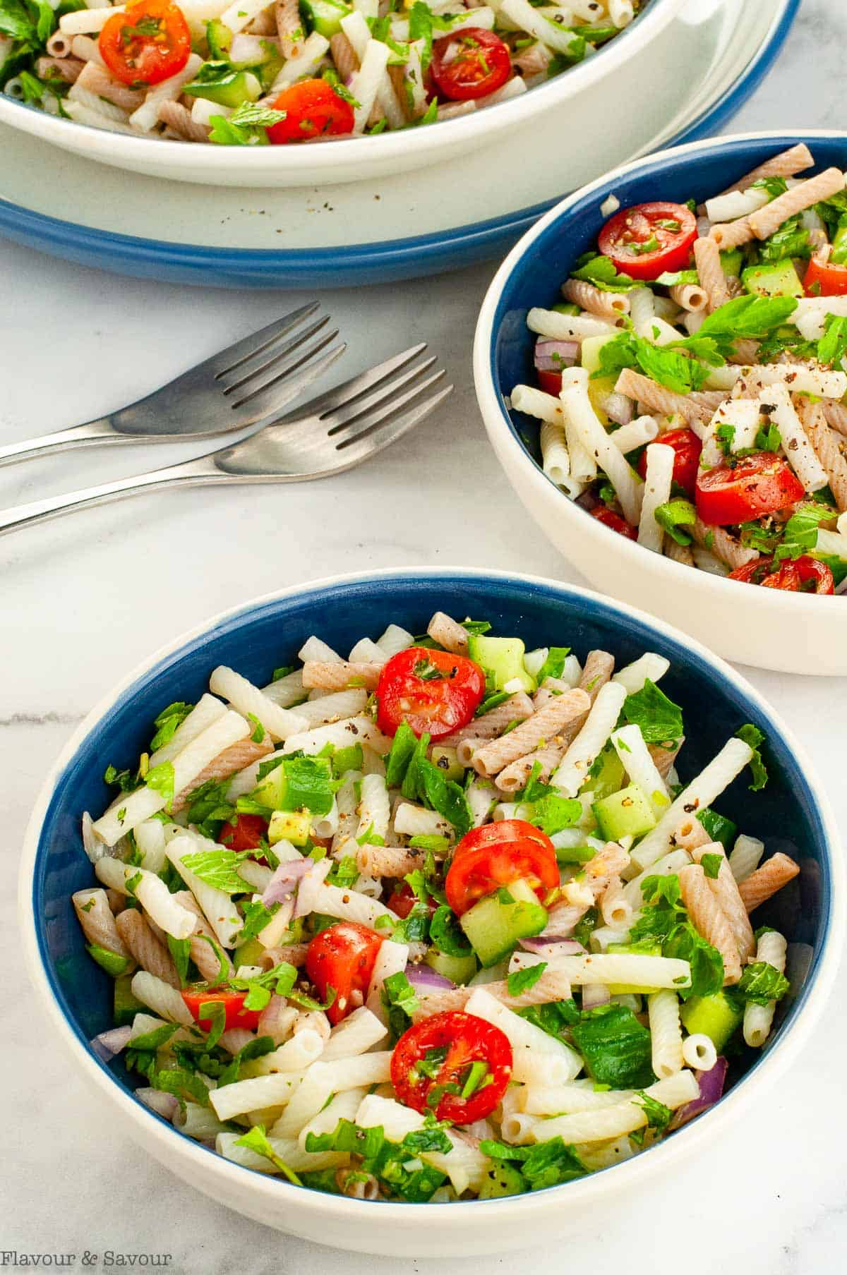Tabouli Pasta Salad in three bowls