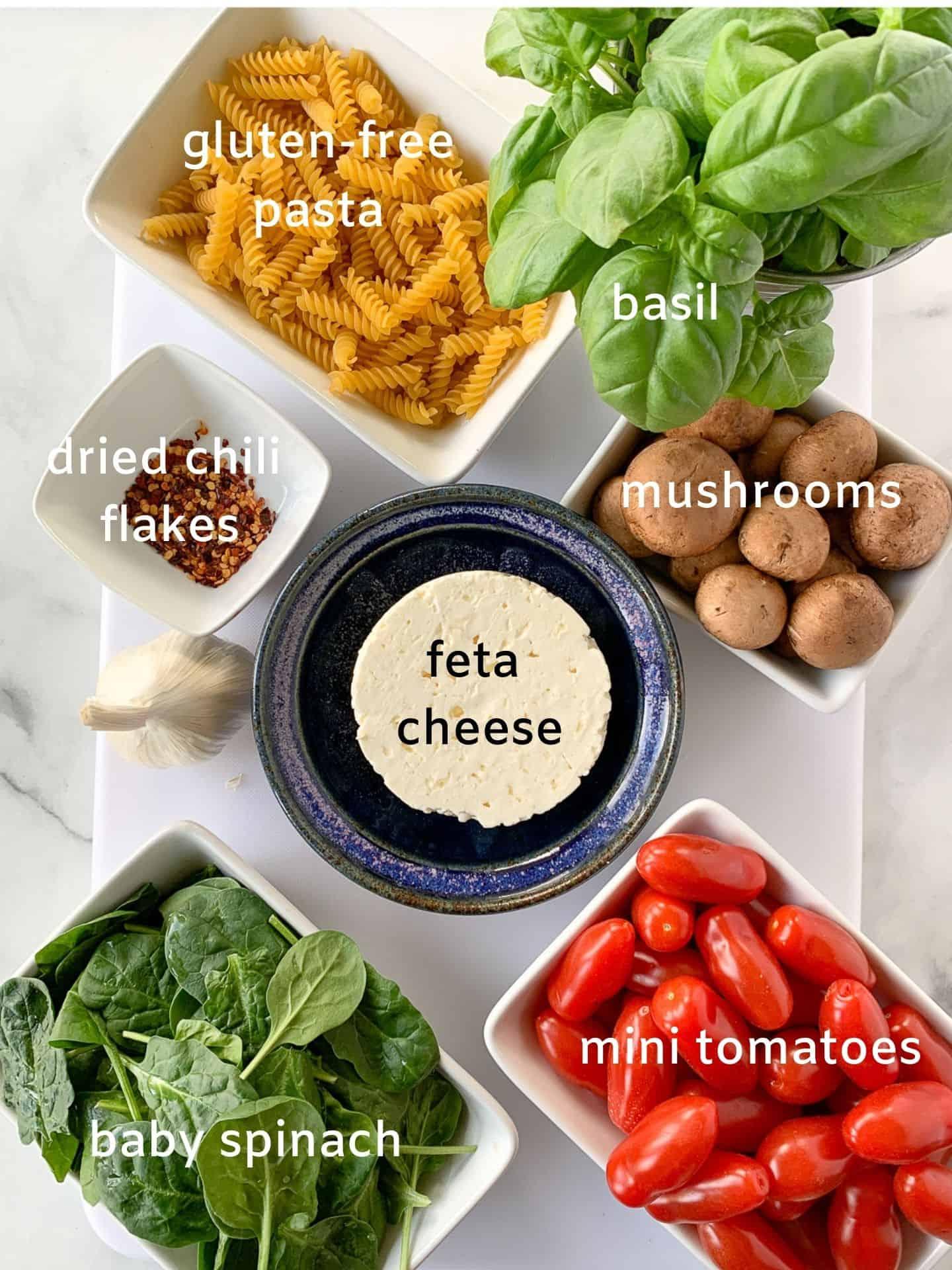 Labeled ingredients for feta tomato pasta bake