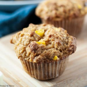 Close up view of a single Gluten-Free Mango Coconut Muffin