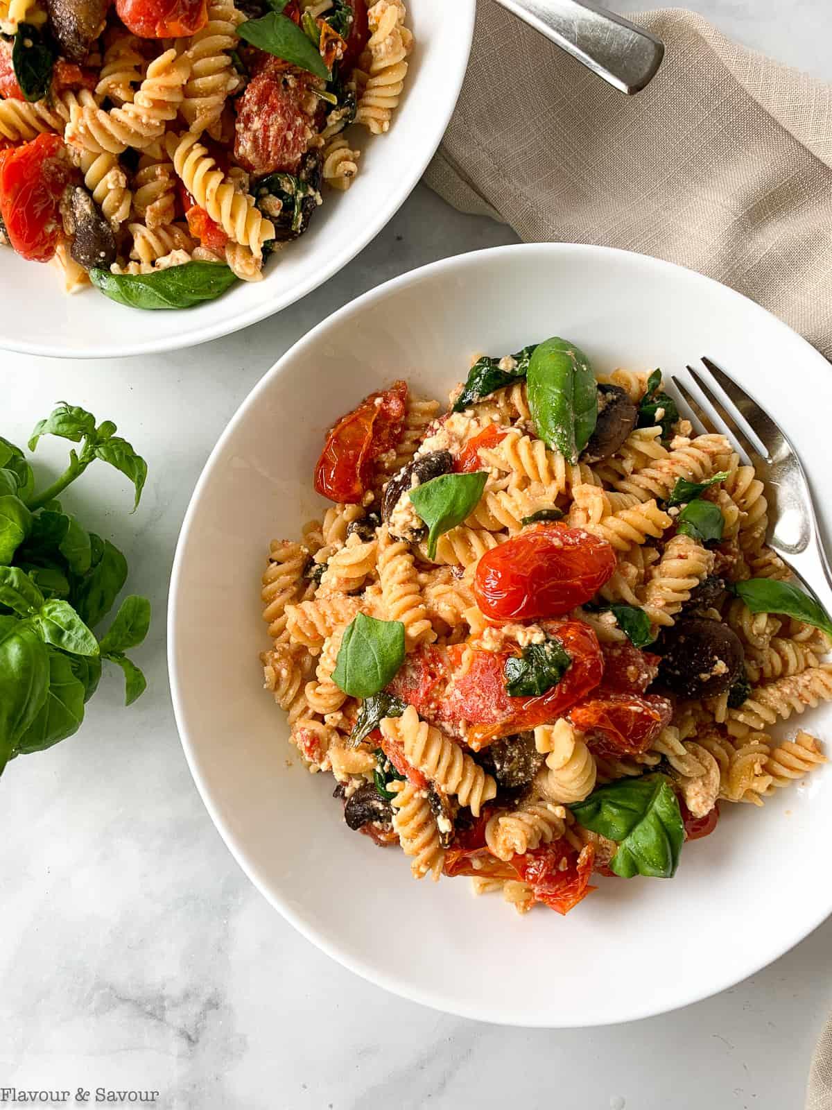 Two bowls of gluten-free feta tomato pasta bake