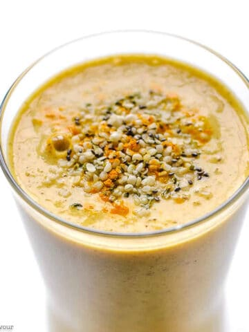 text and close up view of tropical turmeric smoothie with hemp and chia seeds