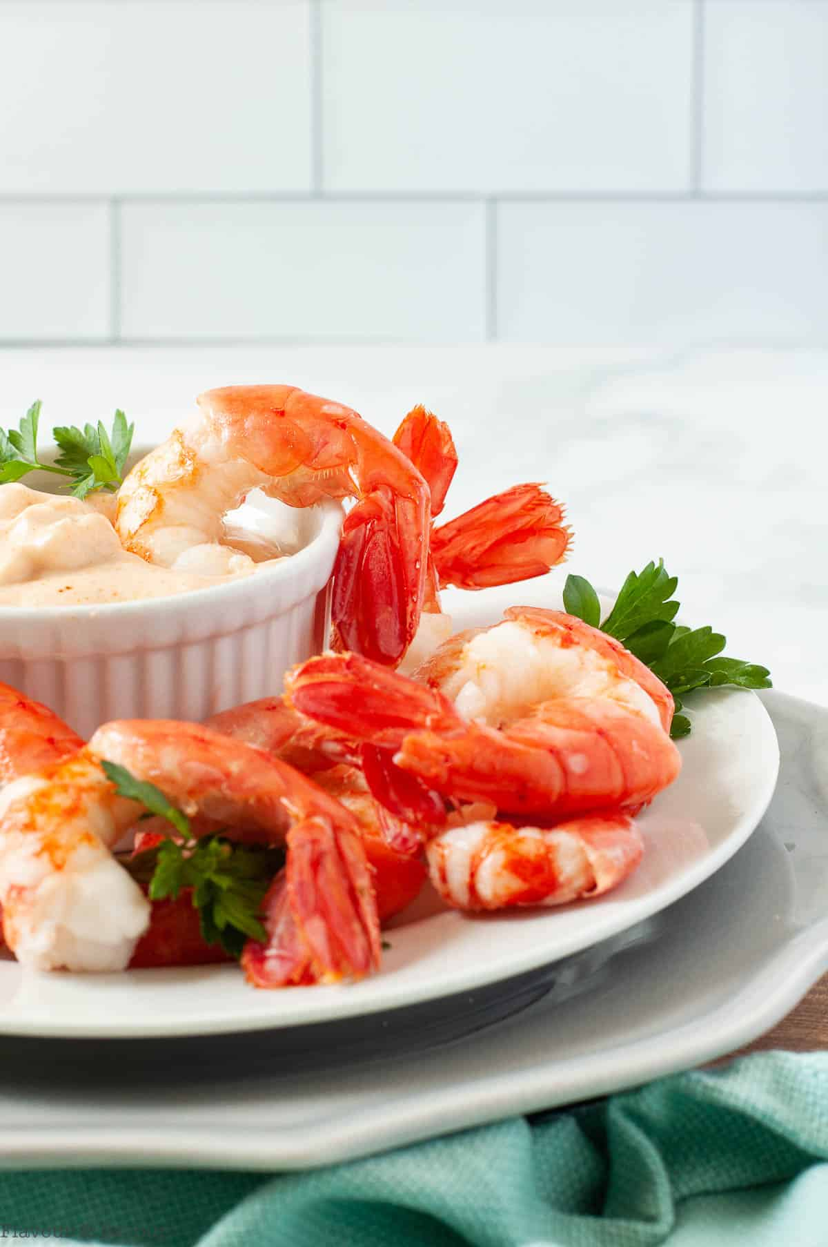 side view of a plate of shrimp with dip