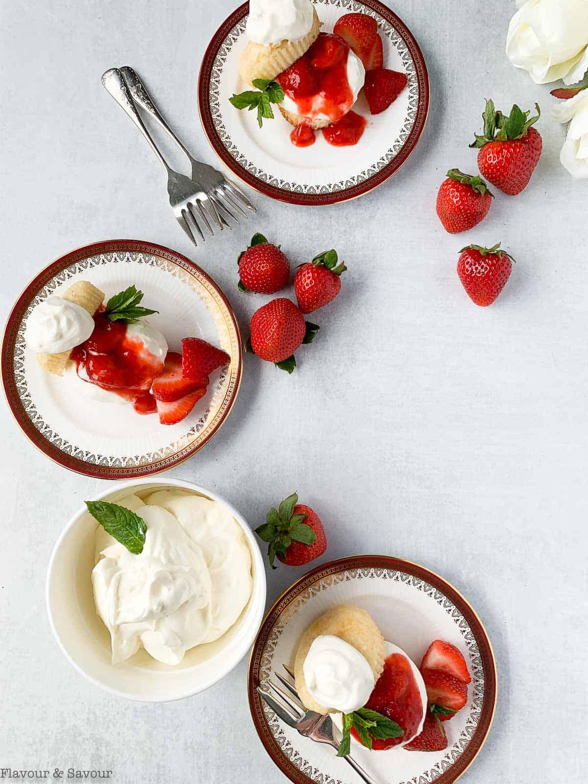 Three dessert plates with strawberry shortcake.