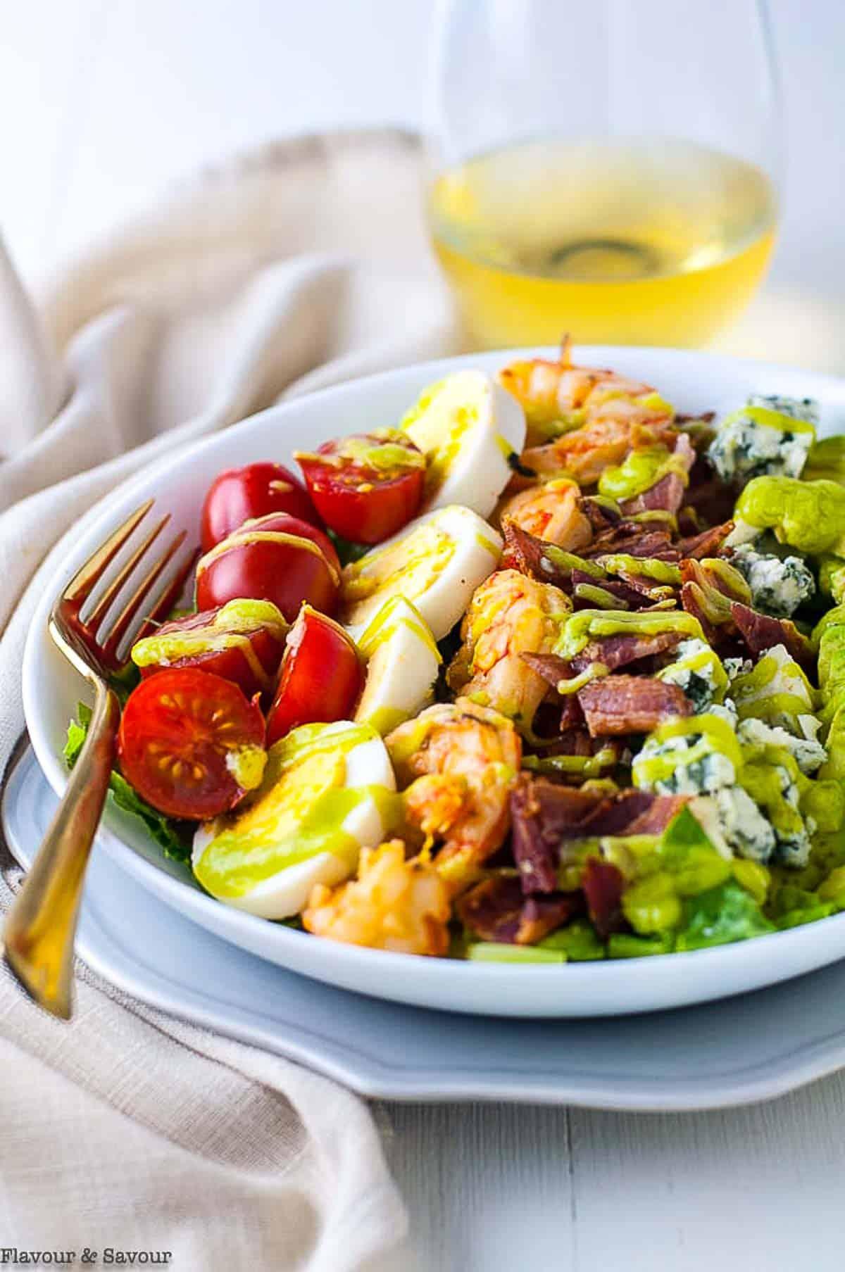Lemon Garlic Shrimp Cobb Salad in a bowl with a fork.