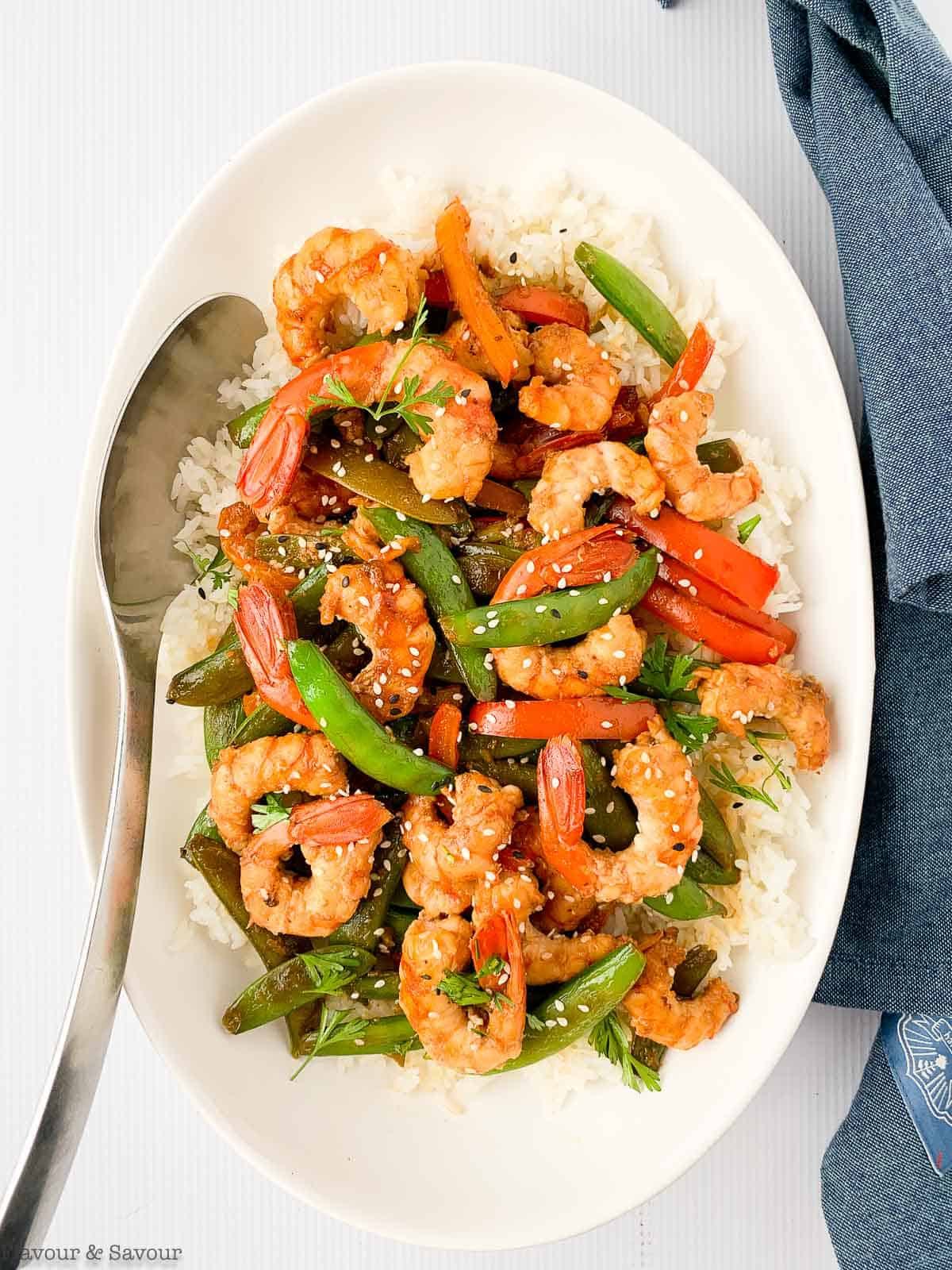 Overhead view of an oval bowl with Lemon Garlic Shrimp and Snow Pea Stir Fry