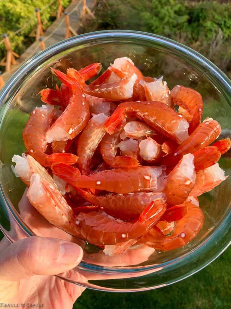 Spot prawn tails in a glass bowl