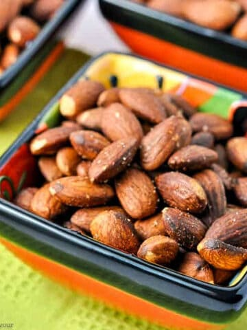 a small square bowl filled with Spanish spiced almonds