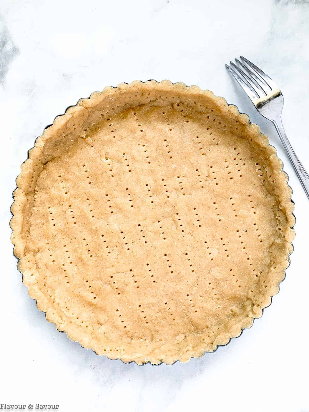 almond flour pie crust pricked with a fork