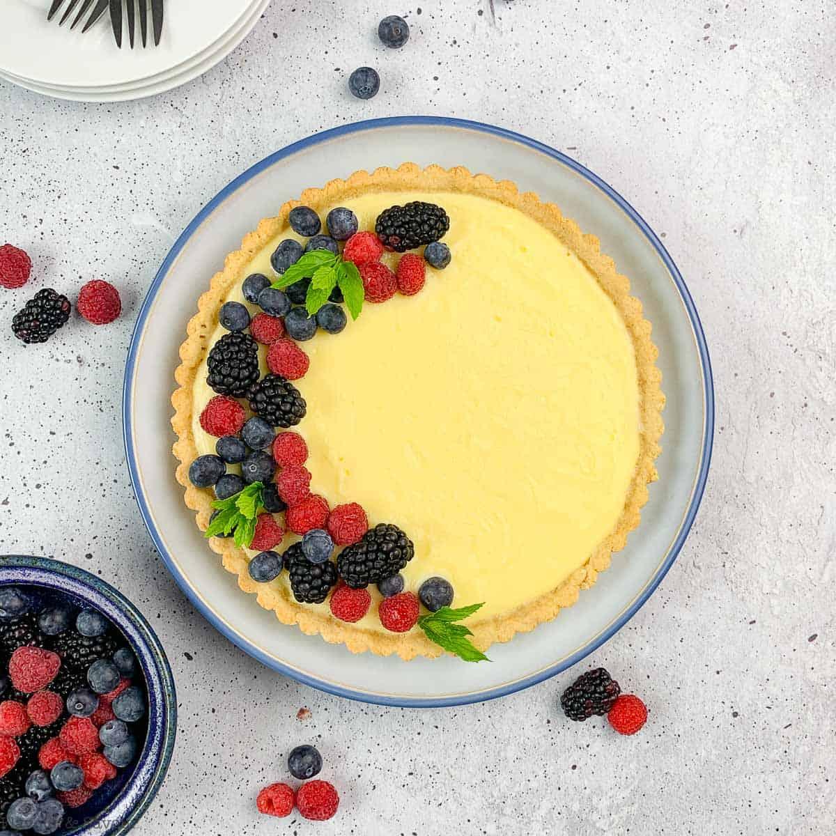lemon curd tart in a round pan