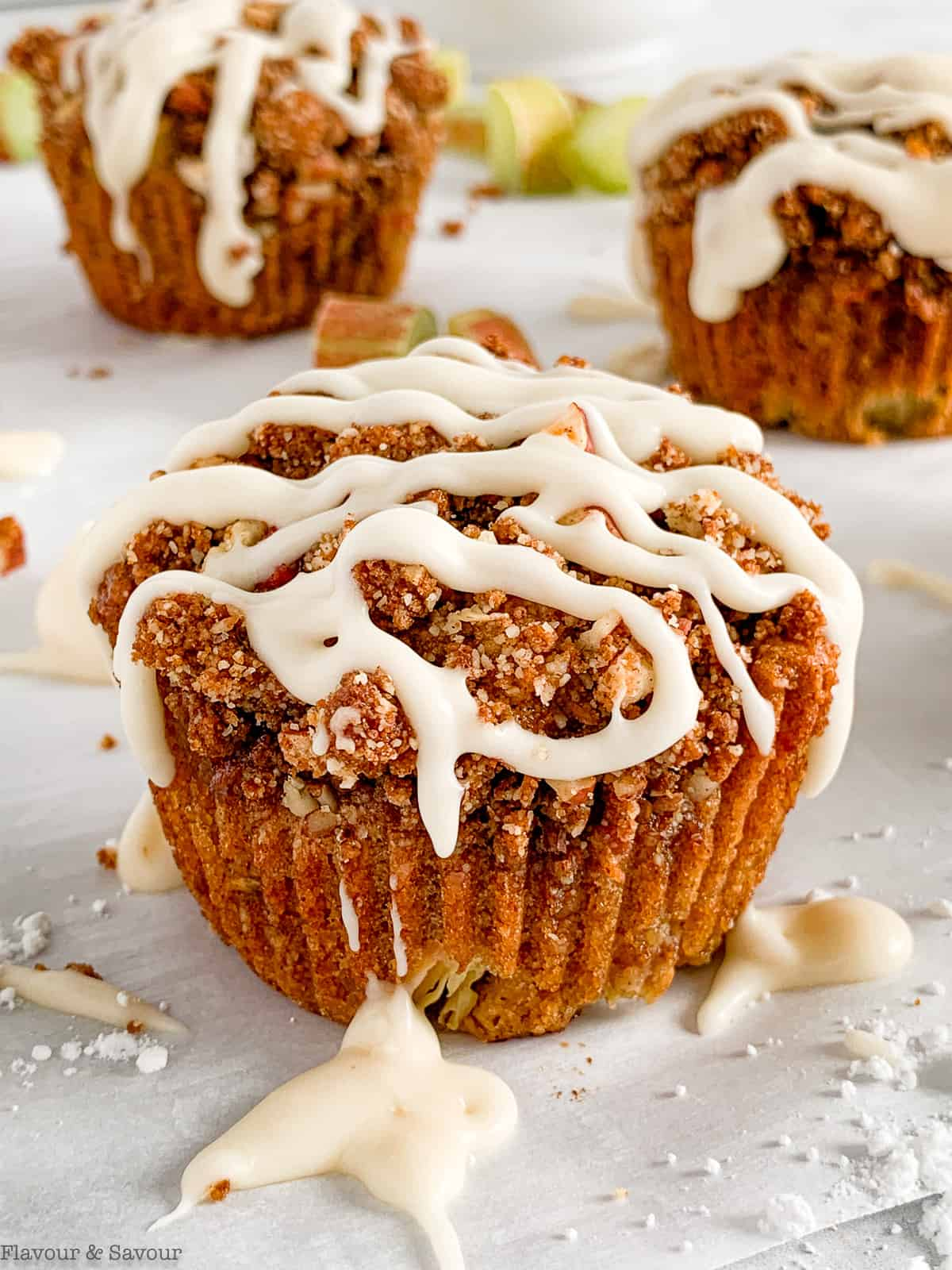 A gluten-free rhubarb muffin with streusel topping and vanilla glaze