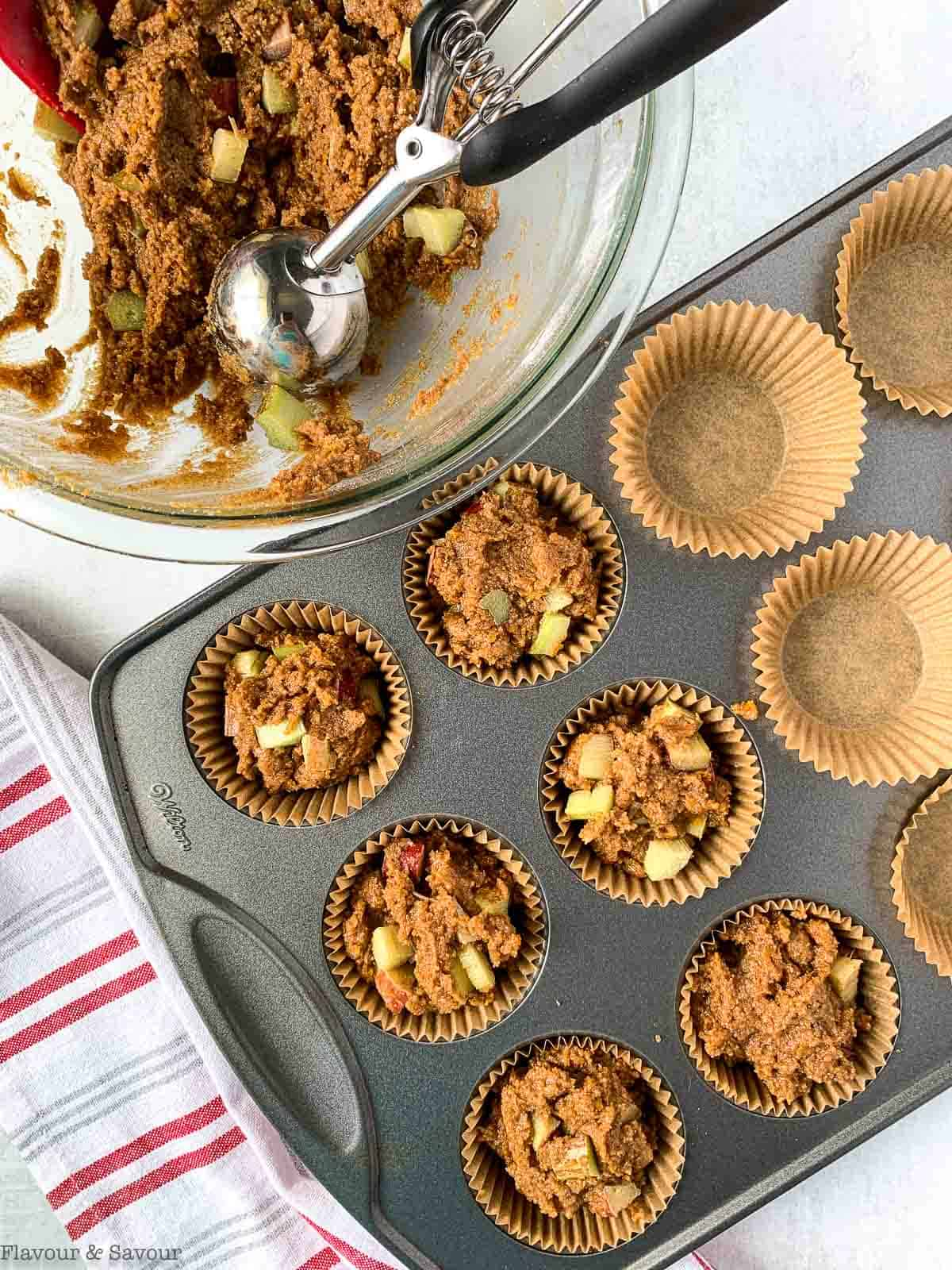 rhubarb streusel muffin batter in a muffin tin