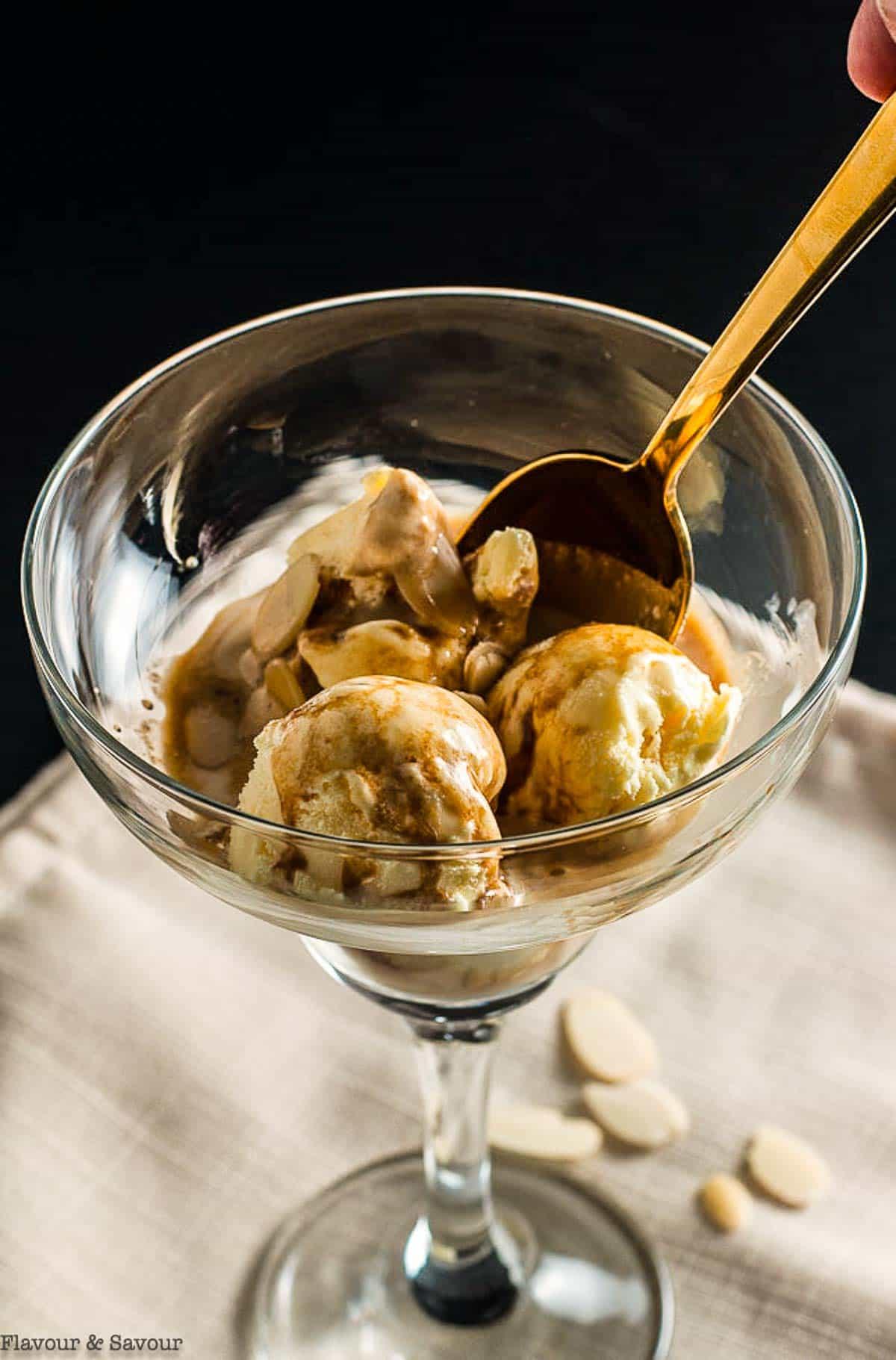 a spoonful of affogato coffee dessert with ice cream and espresso