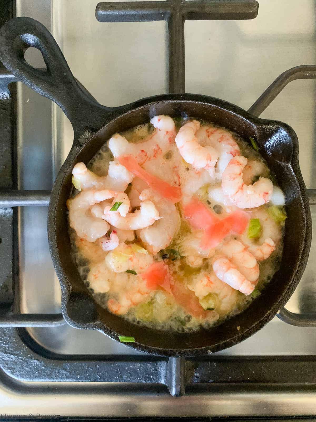 adding pickled ginger to shrimp in skillet