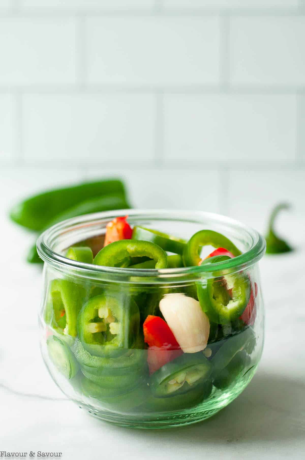 slice jalapeño peppers in a jar