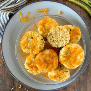 a plate full of zucchini cheddar muffins