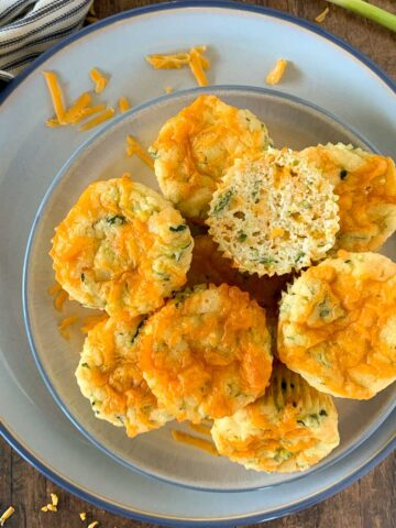 a plate with zucchini cheddar muffins