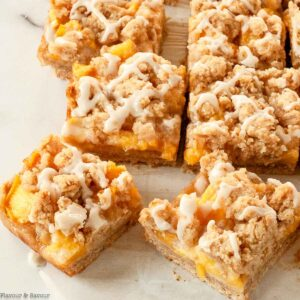 Gluten Free Peach Crumble Bars with vanilla frosting