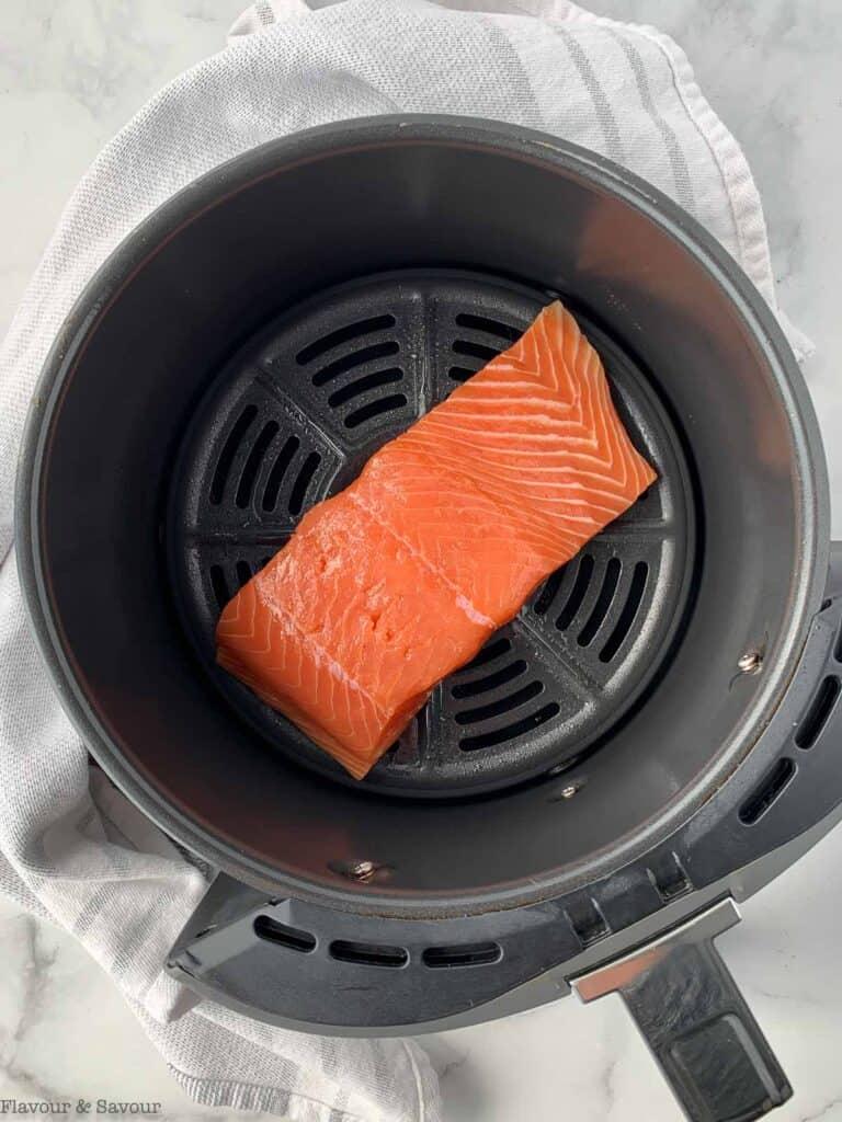 a salmon fillet in a Ninja air fryer basket