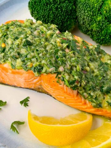 air fryer chimichurri salmon on a plate with lemon wedges