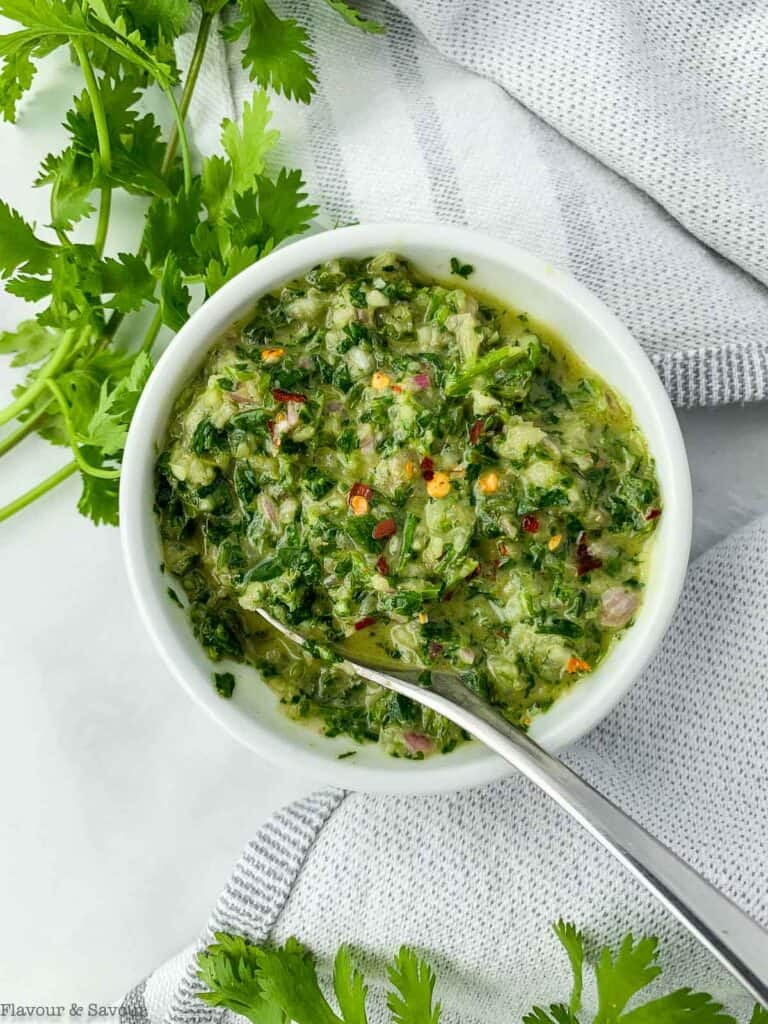 Chimichurri sauce in a round bowl.
