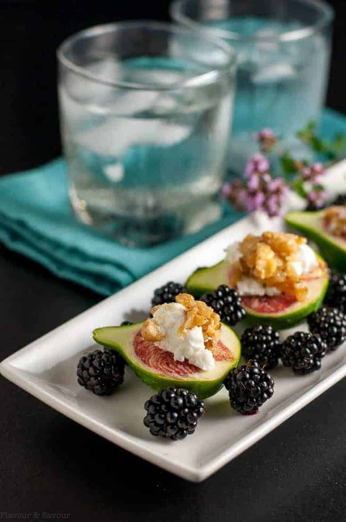 Fresh figs with goat cheese and maple walnuts with blackberries