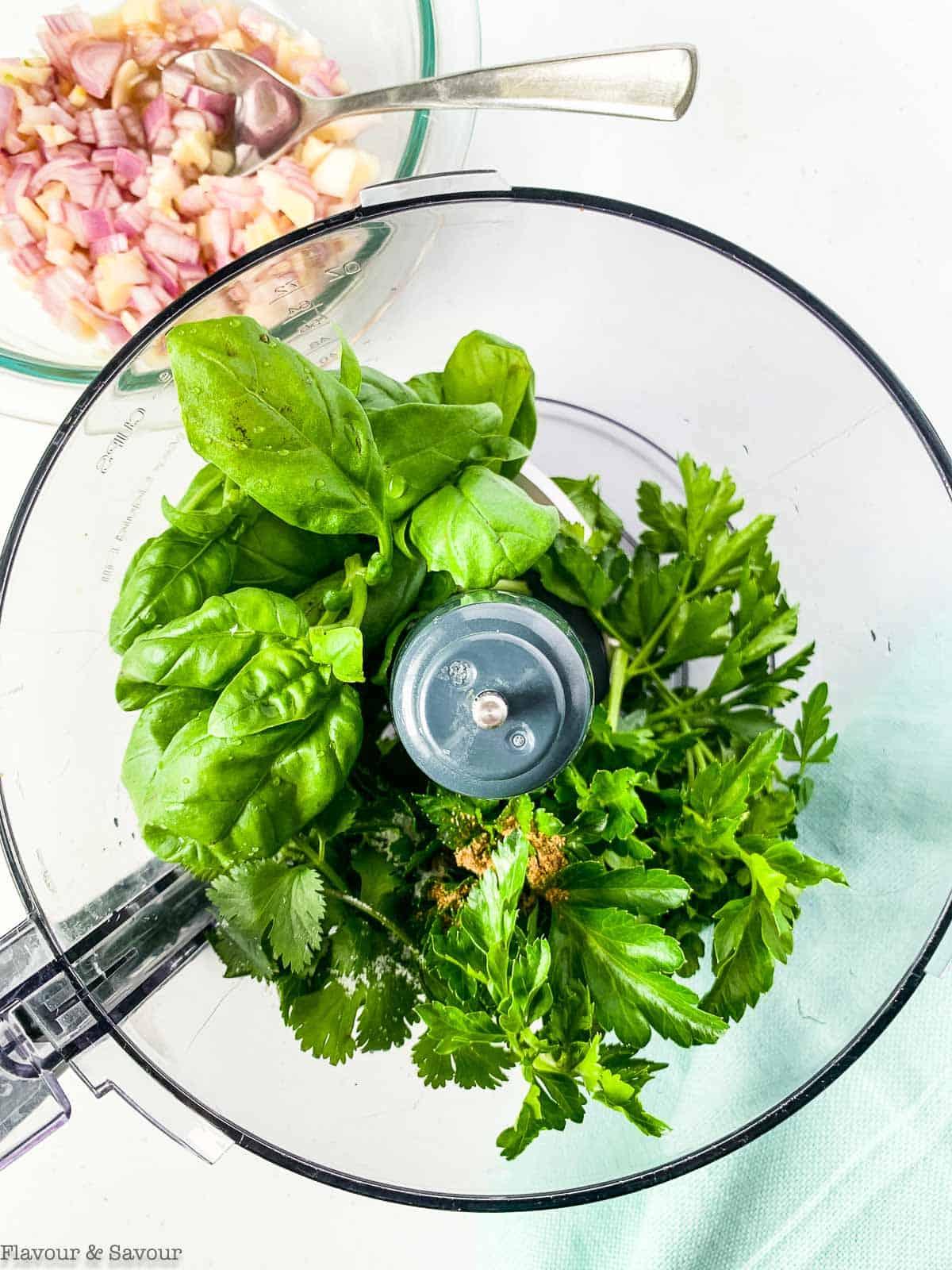 add herbs to food processor to make chimichurri sauce for salmon