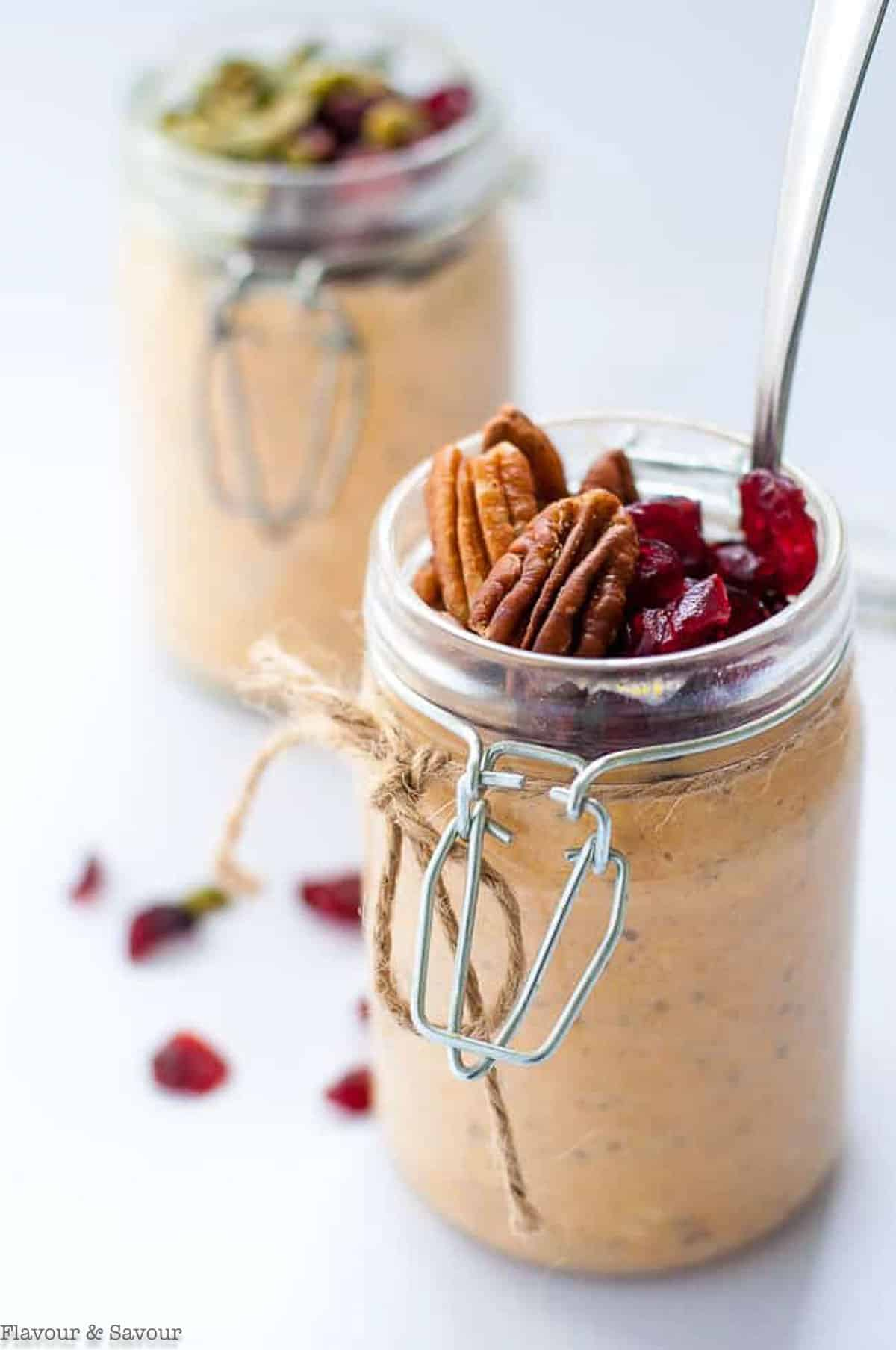 close up view of toppings in a jar of pumpkin spice overnight oats