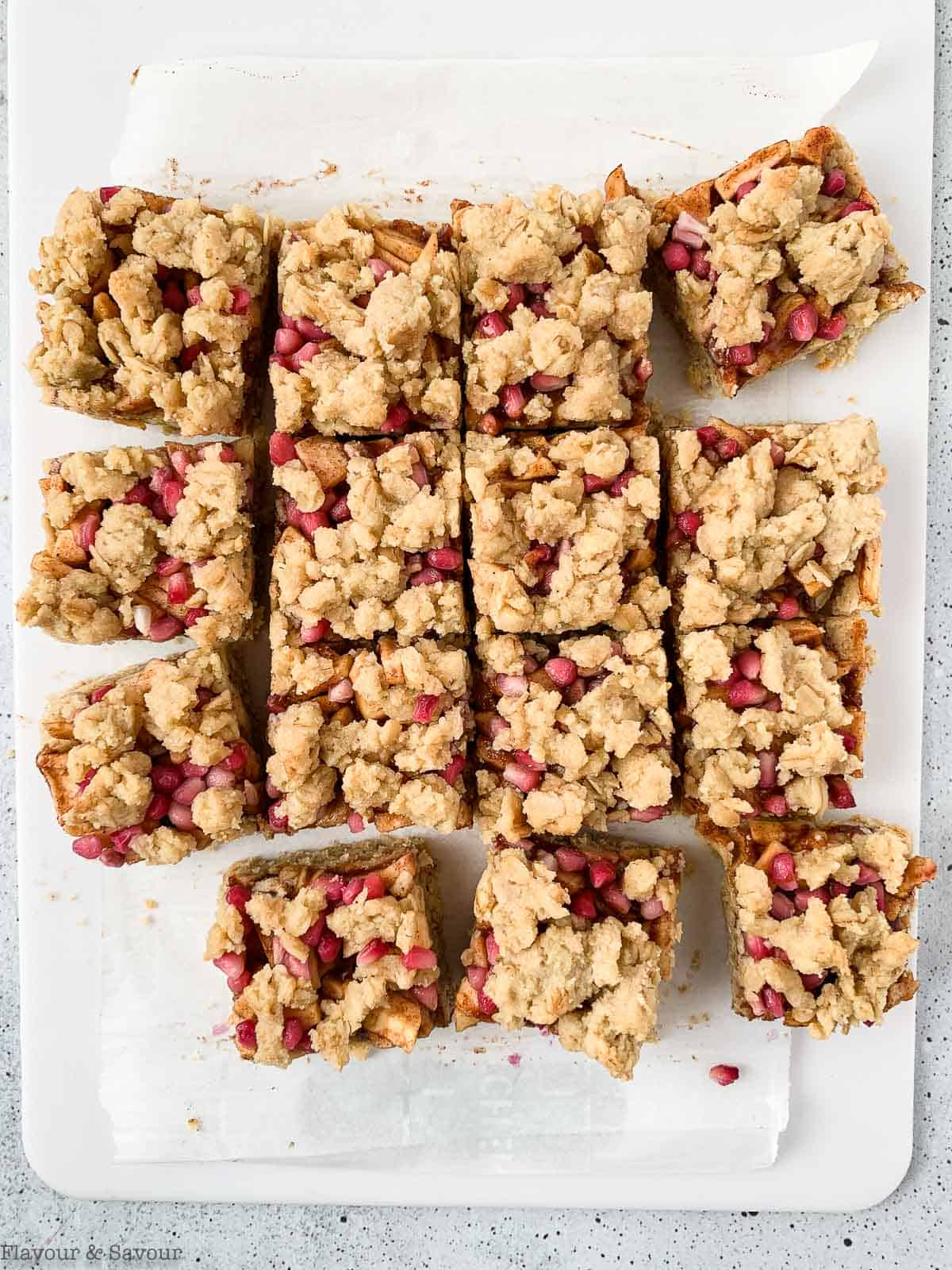 Apple Pomegranate Crumble Bars on a cutting board